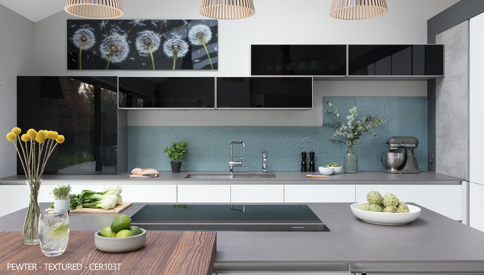Ceralsio Pewter grey textured worktop with wooden island and blue splash back and black gloss cupboards